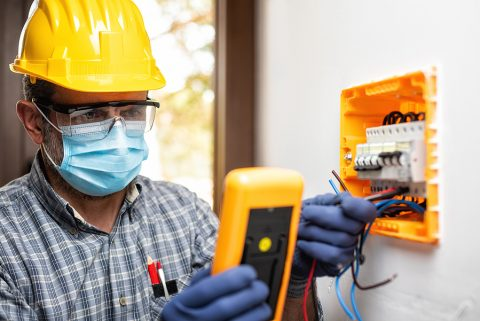 Electrician at work during a pandemic