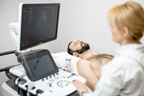 Doctor doing a Liver Scan to a male patient
