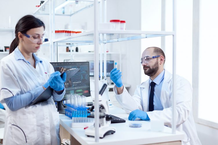 Two compounding chemist in Australia doing experiments in a lab