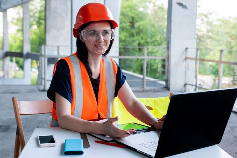 Female worker using a construction ERP software on site