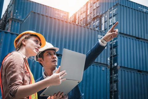 Workers of freight forwarding companies doing an inspection on site