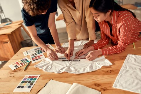 Group of people planning design for custom t shirts in Brisbane